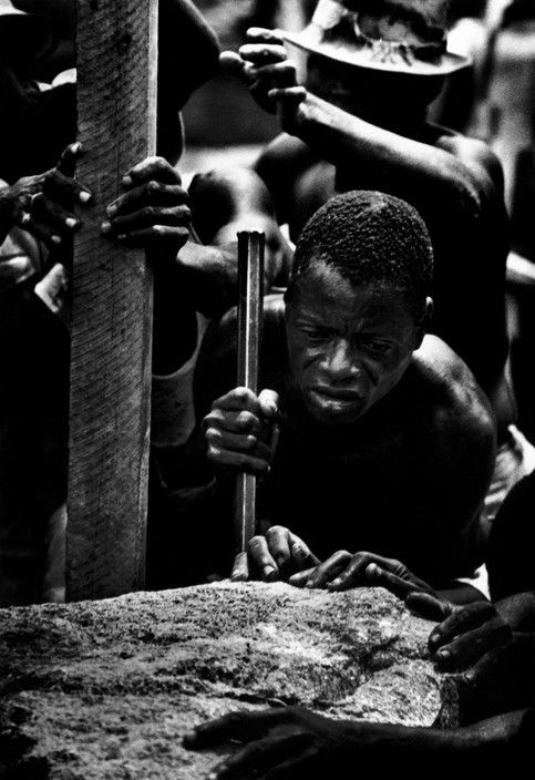 French Equatorial Africa. Gabon. Lambarene. 1954. Workers removing rocks from the Mission Hospital's main street by William Eugene Smith