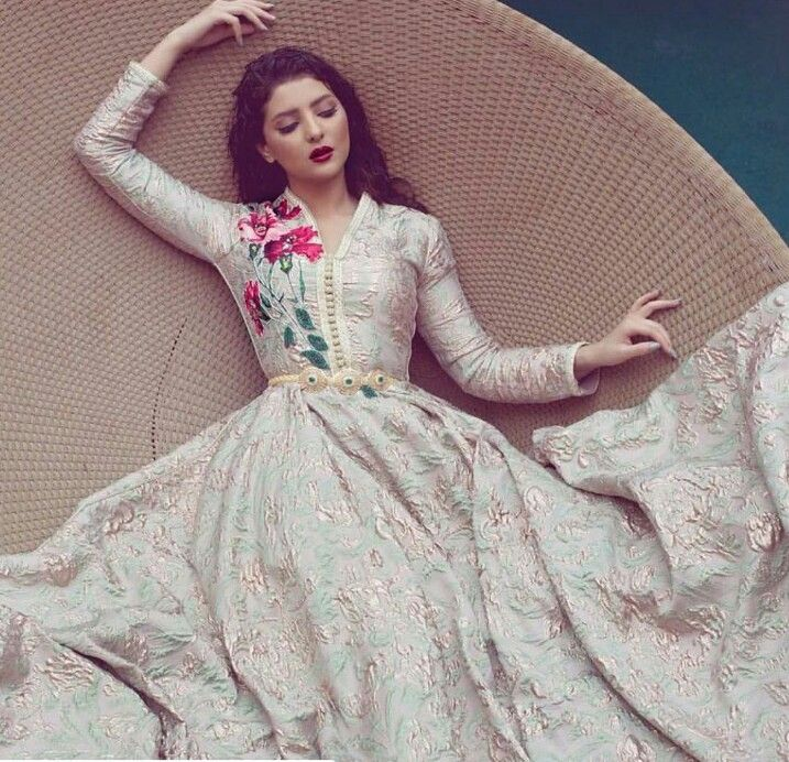 Salma Benomar caftan. Love the whimsy of the fabric and the embroidery combined.