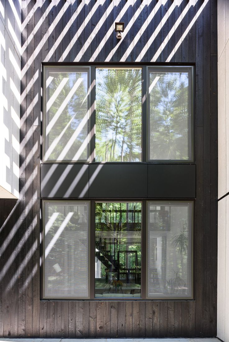 New York home swaps plywood siding for charred timber and cement