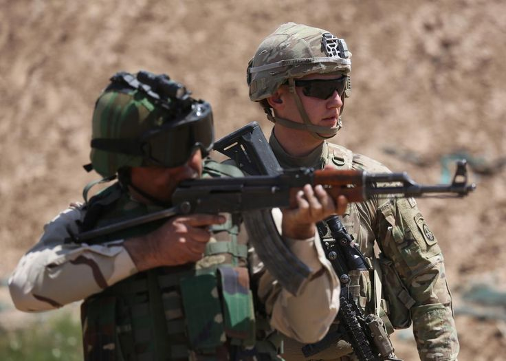An example of how U.S. troops help train Iraqi and Kurdish fighters to attack ISIS