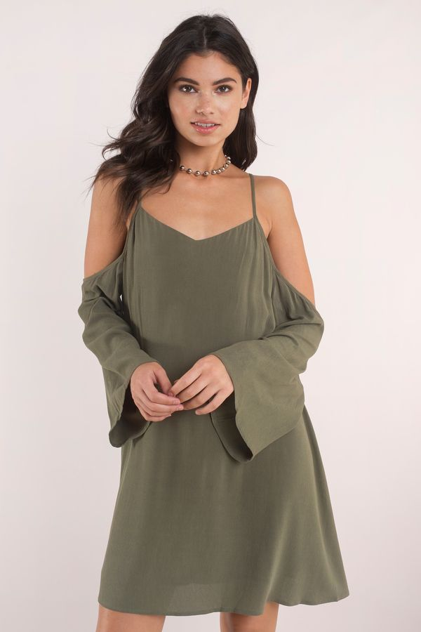 Channel your inner boho-chic look in the Tuscan Nights Cold Shoulder Dress. Loose-fit swing dress with cold shoulder silhouette and criss cross straps #shoptobi