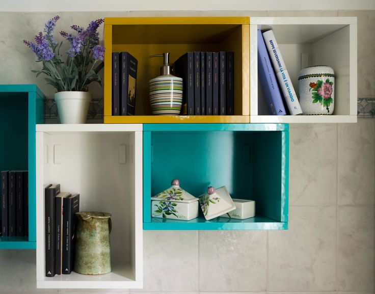 These wall mounted multicoloured storage cupboards/bookshelves look gorgeous.