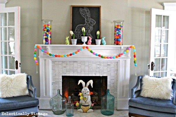 love this happy and colorful mantel! - Spring Mantel & DIY Egg Garland via www.eclecticallyvintage.com