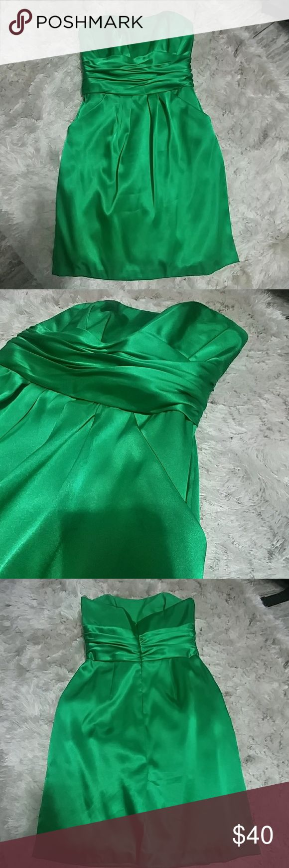 "🍀SALE!!! St. Patrick's Day Green satin dress 🍀 Satin Strapless  Worn once as a bridesmaid  Size 6  Has 2 pockets in the front!  Beautiful rouching around waistline  Zipper in back  I am 5'6"" and this fits 1"" above knee davids bridal Dresses Strapless"