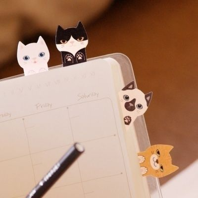 The best companion for a book? Kitty sticky notes!