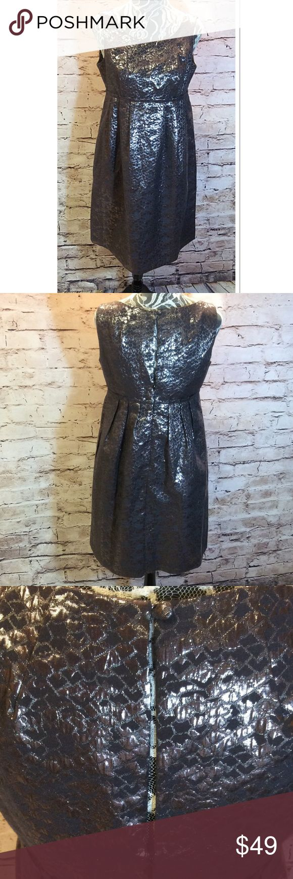 SZ 8 LONDON TIMES SILVER METALLIC DRESS This is beautiful and classy. Metallic material with an empire waist. Button and zip at the back with a slit opening between London Times Dresses
