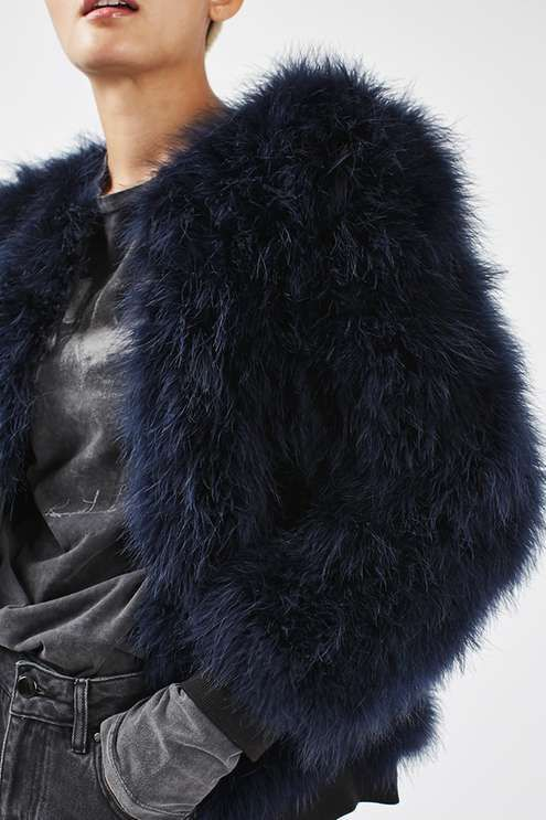 We love the luxe look of this marabou feather jacket in navy blue. In a stand-out style, it features hook and eye fastening. Throw over any casual or party piece for instant impact. #Topshop