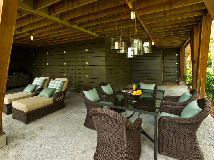 Just Below The Main Deck A Ground Level Gathering Spot Features Full Dining Area Chaise Lounges And An Outdoor Shower