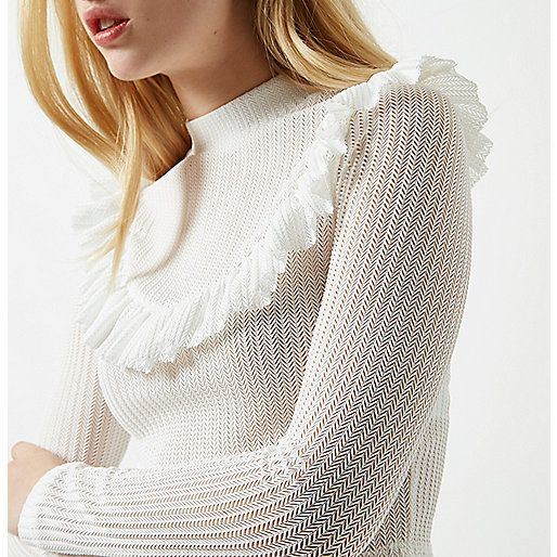 Jersey ribbed fabric Frill bib detail Turtle neck Long sleeve Cropped length Our model wears a UK 8 and is 175cm/5'9'' tall
