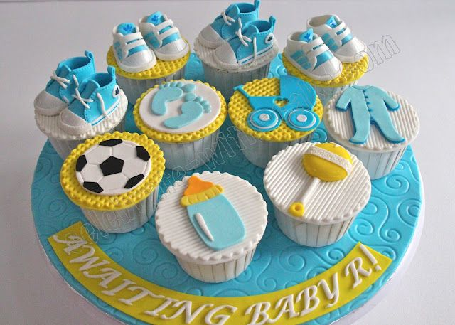 Baby Shower Cupcakes With Combination Of Different Decorations Like Baby  Shoes, Bottle Etc.