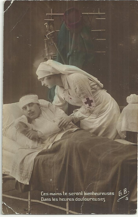 WW1 Red Cross Nurse cares for a French soldier in an ...