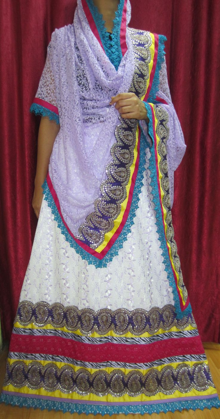 White with lilac purple chikan rida cum jodi designed using Guipure lace, pink chikan panel, trims and purple sequinned motif panel along with a lace net dupatta. An occasional wear ideal for weddings or events !