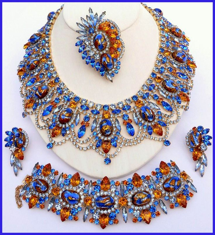Blue Venetian - 2008 DiMartino Originals is the signature of a Tennessee artist who has been making jewelry for more than 20 years. She taught herself the almost-lost art of costume jewelry making; combining it with her copious artistic talent, she has created some of the most beautiful rhinestone jewelry. She uses primarily Swarovski Austrian crystal rhinestones, vintage and hand-painted cabochons, many of which are no longer being made.
