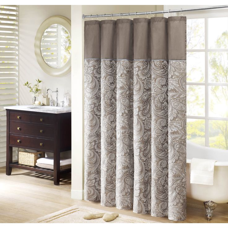Add some classic style to your bathroom with this faux silk shower curtain from Whitman. Featuring a beautiful woven taupe jacquard in paisley print, this shower curtain will set the tone for the design and style of your guest bathroom.