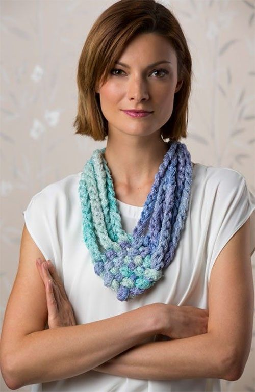 You are used to seeing Sashay yarn used for ruffled scarves, but here is a stunning alternative. Using it as it comes off the ball, first chain it and then weave the chains. In little time you will have the perfect wardrobe accessory.