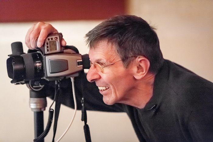 "Leonard Nimoy taking a photograph for ""Secret Selves."" SETH KAYE PHOTOGRAPHY"