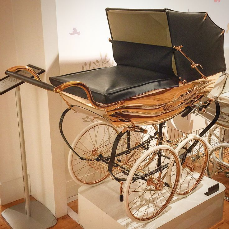 Ok...this is a hand made Silver Cross Balmoral pram in 18ct rose gold...stumbled across it in Harrods and the price tag...a rather extreme £42,000!!!