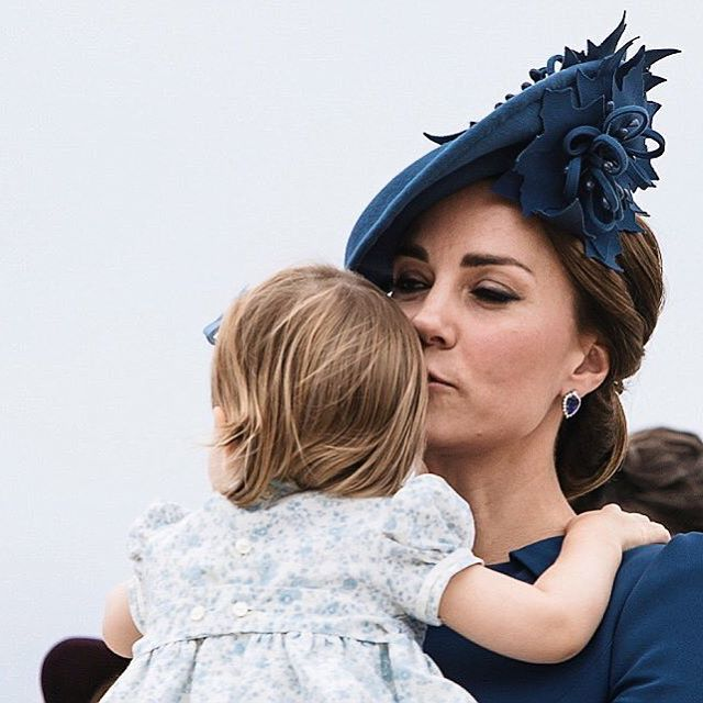 The Duchess of Cambridge plants a kiss on Princess Charlotte as they arrived in Victoria #RoyalTourCanada