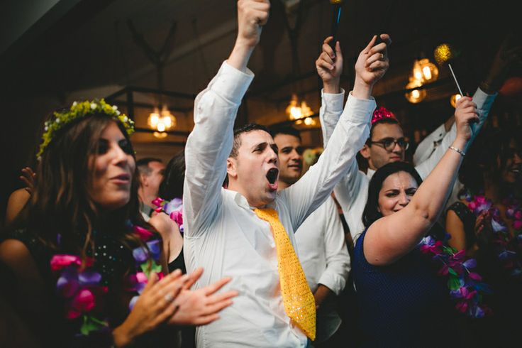 Groom and friends and family cheering on bride at wedding!