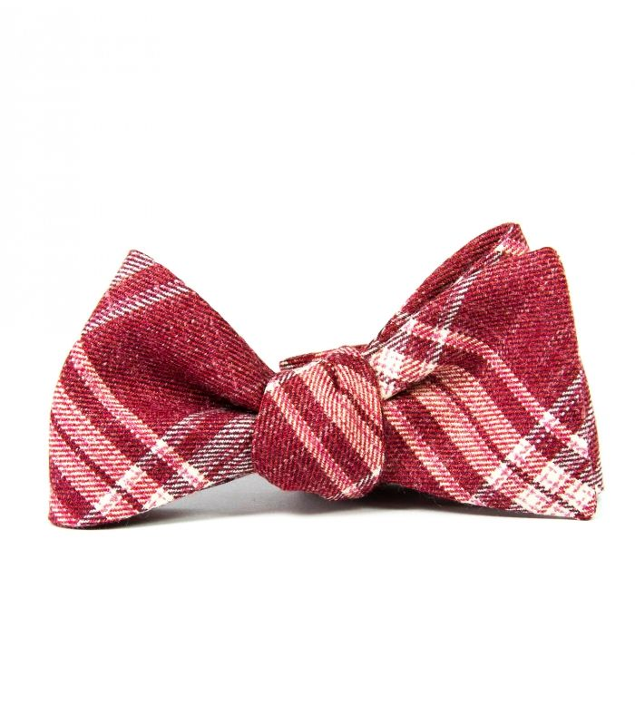 All our woolen stuff is made from the best quality italian fabrics. This self-tie woolen bowtie is in fresh plaid in red, grey and white.