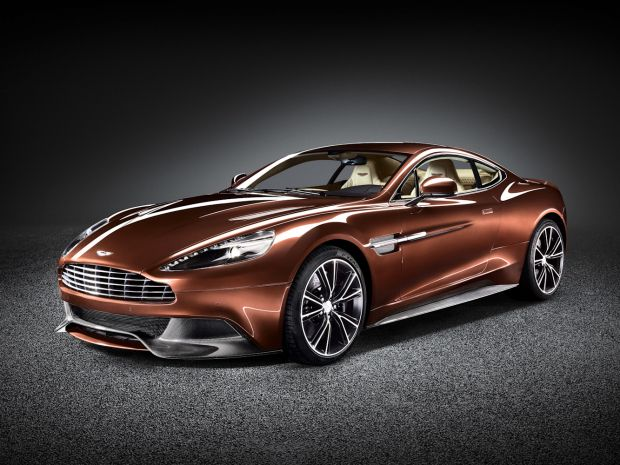 The newest Aston Martin model revives the best model name in the automotive industry. The Vanquish replaces the DBS in the company's line-up and retains the grand tourer style. The Vanquish uses a 6-liter V-12, producing 565 horsepower. Aston Martin boasts a 183 mph top speed and zero to 62 mph time of 4.1 seconds.