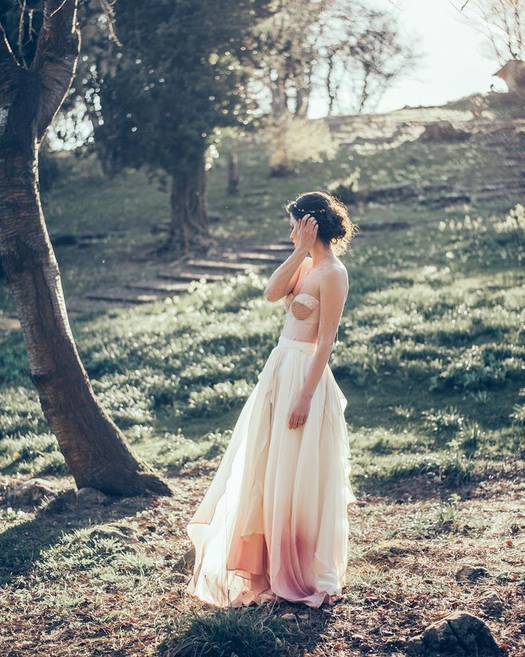 We just adore all of @jessturnerdesigns dresses but this one just makes our hearts sing - the ultra modern chic corset top with the romantic dip dyed skirt are what wedding dress dreams are made of. . . Team credits: @stormemakeupartist @kittywshaw photographer @jessturnerdesigns designer @pswithlove3 jewellery and hair pieces @quitbeingweird model @danesfieldhouse venue  @boom_blooms florist @dolcelussocakes cake @hollyreeslondon stationary @classiccrockery tableware