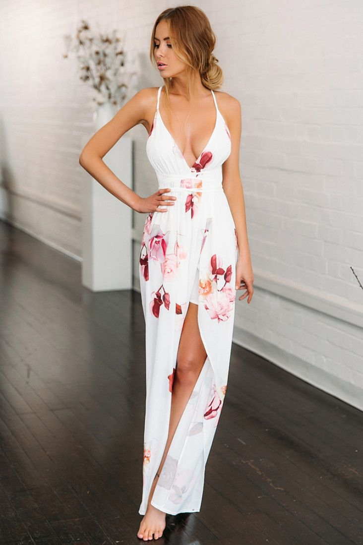 We're in vacation mode in the Take Me To Milan Maxi Dress! This breathtaking maxi features floral print throughout and has a self-tie at the back that can be worn in multiple ways! The skirt has a wrapover-style design and has a slit up the leg! We love this dress with embellished sandals for added oomph! Maxi dress. Not lined. Cold hand wash only. Model is standard XS and is wearing XS. True to size. Print may vary in placement. Non stretchy fabric. Polyester.