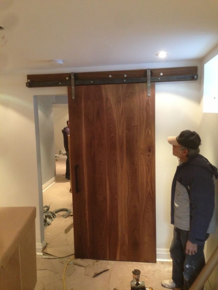 the walnut slab sliding door vertically assembled