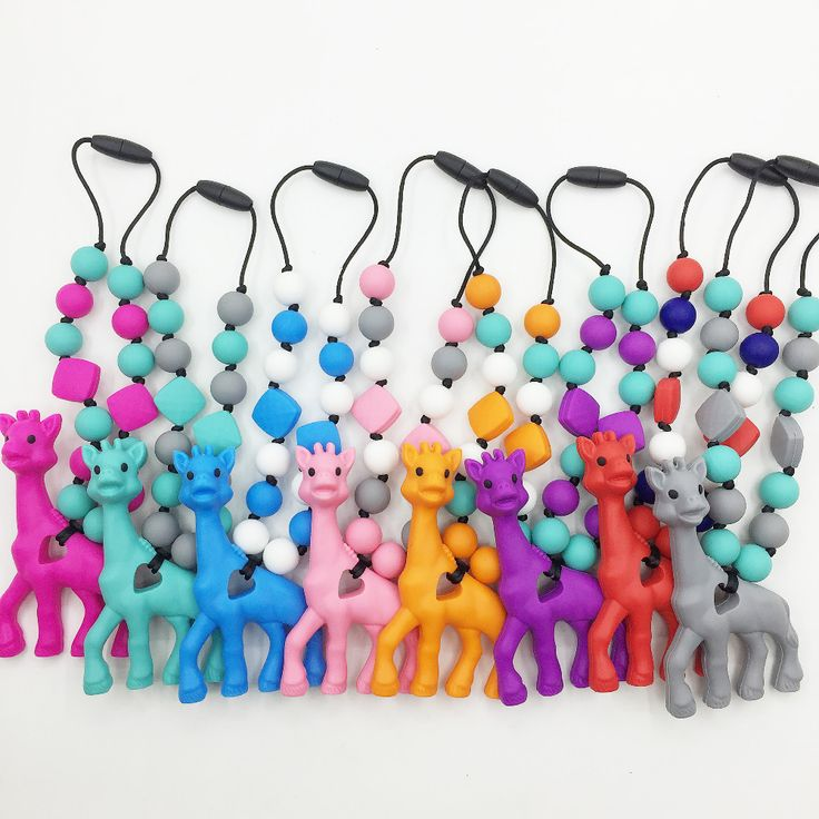 BPA Free Silicone Giraffe Teething Toy for Baby Carrier. Accessory . Babywearing. Silicone teether giraffe carrier