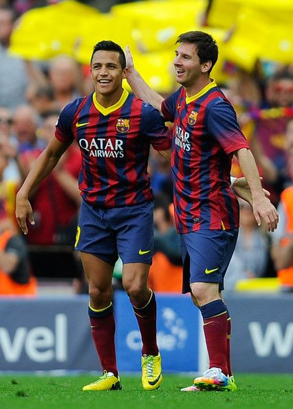 Alexis Sanchez of FC Barcelona celebrates with his teammate Lionel Messi of FC Barcelona after scoring the opening goal during the La Liga match between FC Barcelona and Club Atletico de Madrid at Camp Nou on May 17, 2014 in Barcelona, Catalonia.