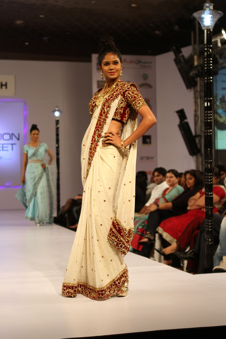 Off white and red wedding saree also called as a panetar is made in a shimmer offwhite georgette fabric with marron velvet blouse full encrusted with swarovski crystals in gold and red stones with intricate and detailed zardosi embroidery by AD SINGH. Buy it now  exclusively online  www.adsingh.com     Follow us: http://www.twitter.com/adsinghdesigns  http://www.facebook.com/adsinghdesigns  http://www.youtube.com/adsinghdesigns