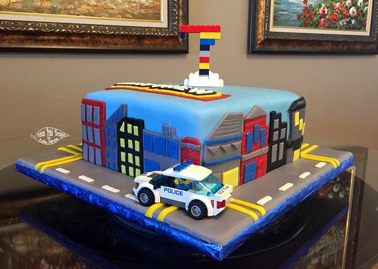 Lego City cake using purchased Legos to make car and number 7.  The rest is hand made from fondant.