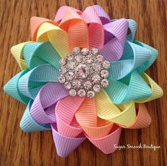 This listing is for ONE bow. If you would like a pair, please send me a convo.  Pastel flower hairbow measuring about 3 across. The bow will be attached to a coordinating colored, grosgrain ribbon lined alligator clip. The bow is made with high quality grosgrain ribbon in the following colors: light pink, peach, light blue, light yellow, mint and lavender. Attached to the center is a vintage style metal rhinestone embellishment. This bow can be attached to a small french clip also. If you…