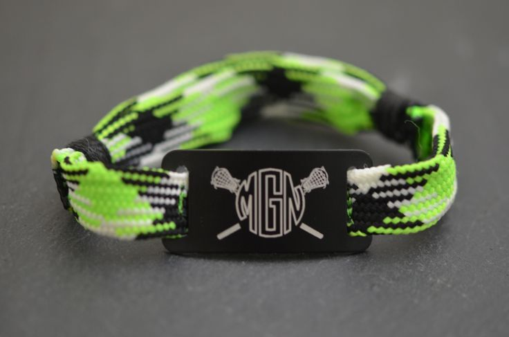 Look at this awesome NEW lacrosse shooting string bracelet design we have come up with! Makes an awesome personalized lacrosse gift for lax girls. This bracelet features our neon green argyle bracelet with a black slider. #monogram #girlslacrosse