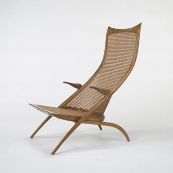 "1956 Dan Johnson Studio Produced in Italy for distribution in America Italian walnut, caning 23.5""w x 30""d x 37.5""h An extremely rare lounge chair by Johnson with finely carved details."
