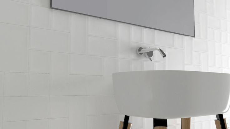 White 3D tiles/panels add an element of excitement to the room without being too overbearing or taking away from a clean look.  Inedita Essential