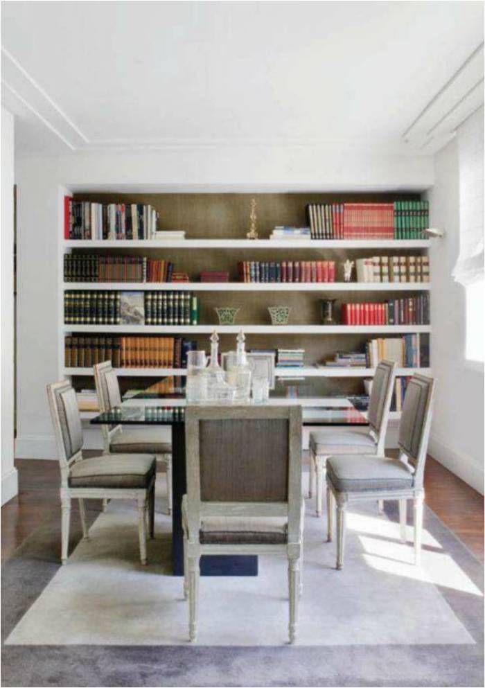 Dining room by Luis Puerta interior designer (bookshelves in room}