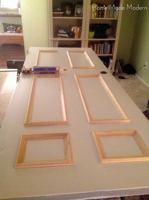 DIY door update = genius!! This blog post said that the update to the door cost $40. I feel like you could purchase a new door for that? what about using dollar store picture frames instead of molding? Could be used on bedroom and bathroom doors too!!