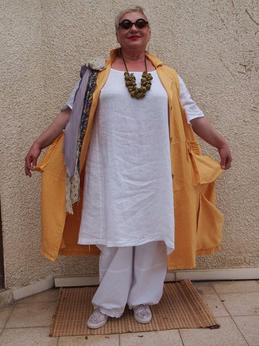 Gold Sleeveless with pockets over white tunic and pants