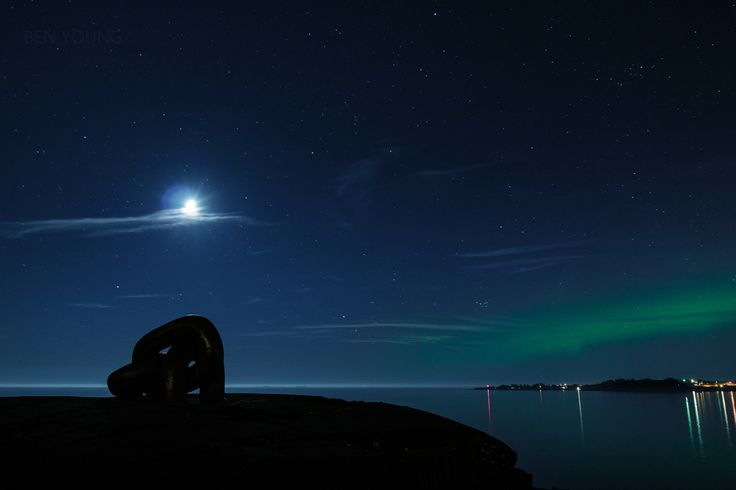 A cold moonlit night - Taken at the Alexander Kielland Memorial looking northwest. I was lucky enough to include some northern lights in my photos this evening.
