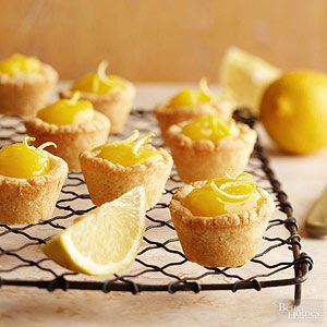 Lemon Curd Tassies Use a mini muffin tin for these bite-size lemony sweets! The bright, slightly tart lemon curd is nestled in a buttery crust and topped with pretty curls of lemon peel.