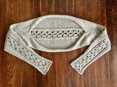 O padrão de tricô de encolher de ombros