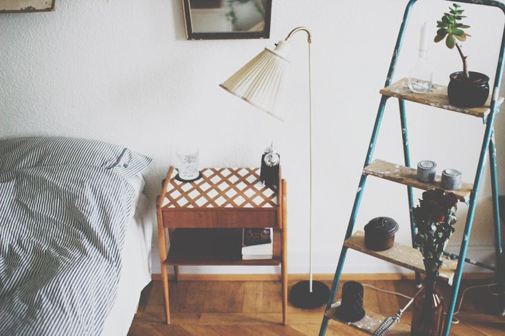 Using a step ladder as a shelf is a great idea - could even work on the balcony!