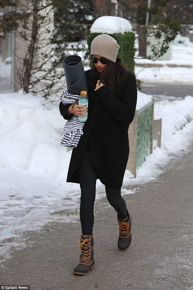 Meghan wrapped up in a black winter coat and wore her trusty £96 Kamik snow boots for her yoga outing