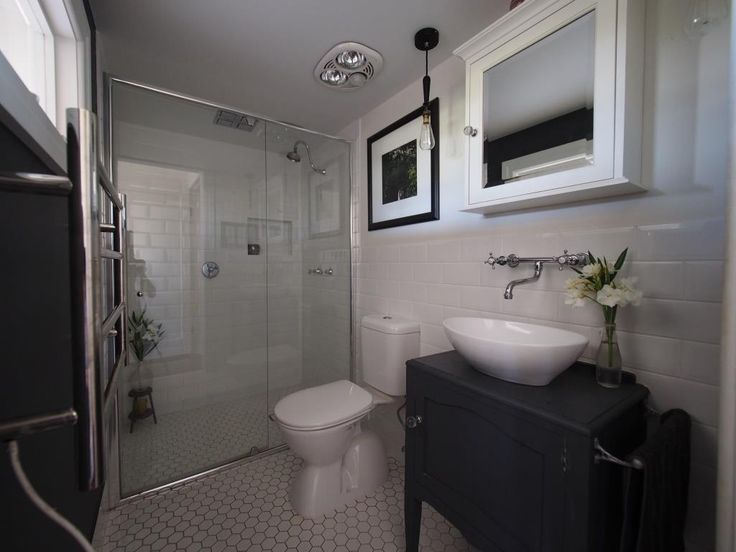 Wide angle Ensuite - semi-frameless shower screen, toilet suite, traditional vanity and basin, tapware, mirror cabinet.