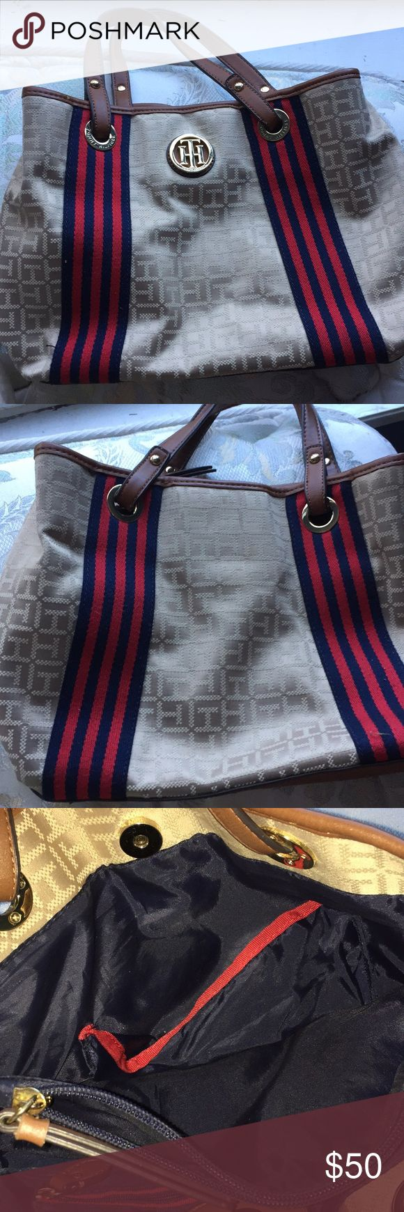 Authentic Brown and Red Tommy Hilfiger Purse This is a completely real Tommy Hilfiger purse. Very clean, NO stains, but one mark on the top. Tommy Hilfiger Bags Travel Bags