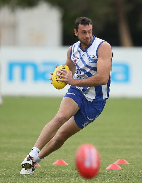 Todd Goldstein of the Kangaroos runs with the ball during a North Melbourne Kangaroos AFL training session at Arden Street Ground on April 3...