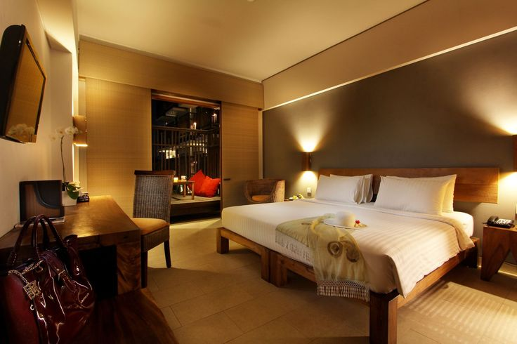 Our Deluxe room with an evening ambiance at The Oasis Lagoon Sanur, Bali.