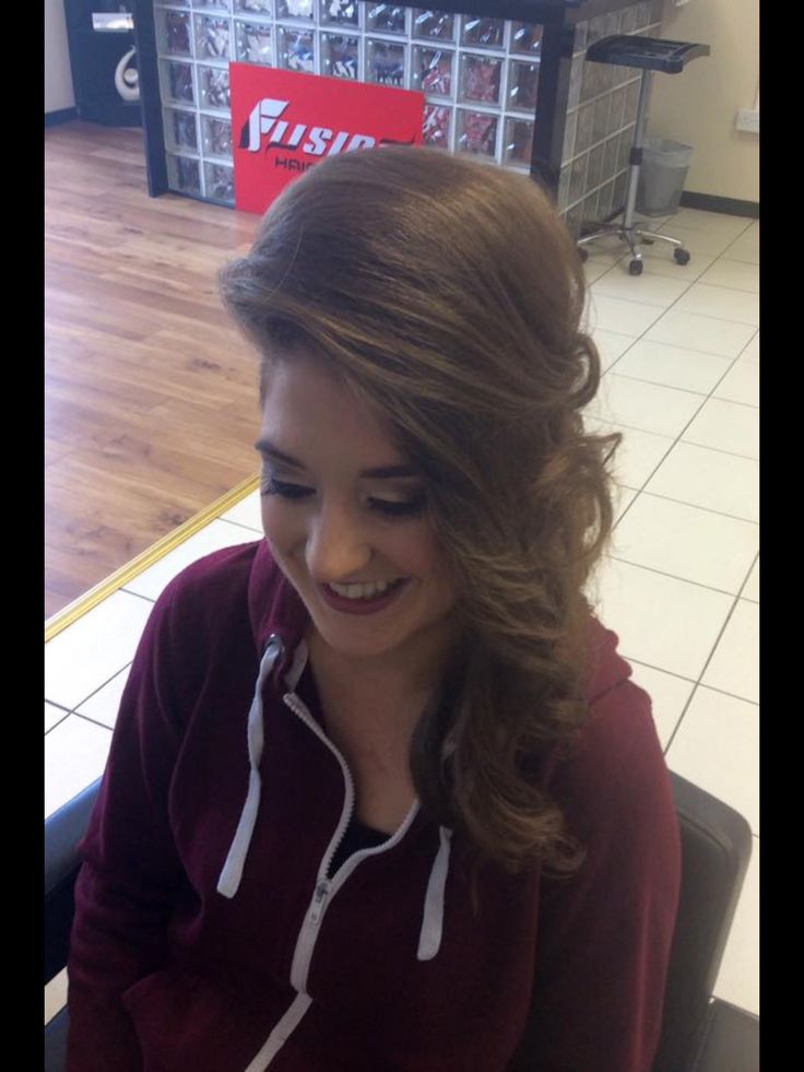 Perfect for a night out, a trendy style curled and twisted to one side with back plait detail & plenty of height