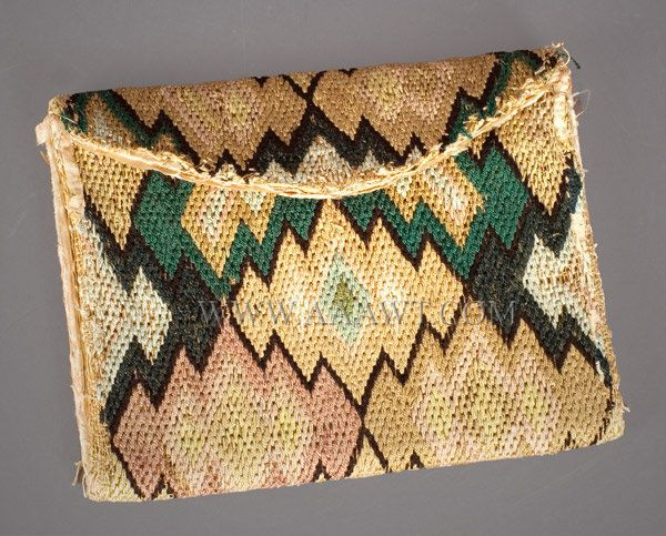 "A two section pocketbook with flap, crewel embroidered silk and wool blend; interior lined with a pink silk. Typical wear and losses; traces of outside edge tape remain; losses to interior, especially gussets, typical of silk. (Dimensions: 6 by 4.5"".)"